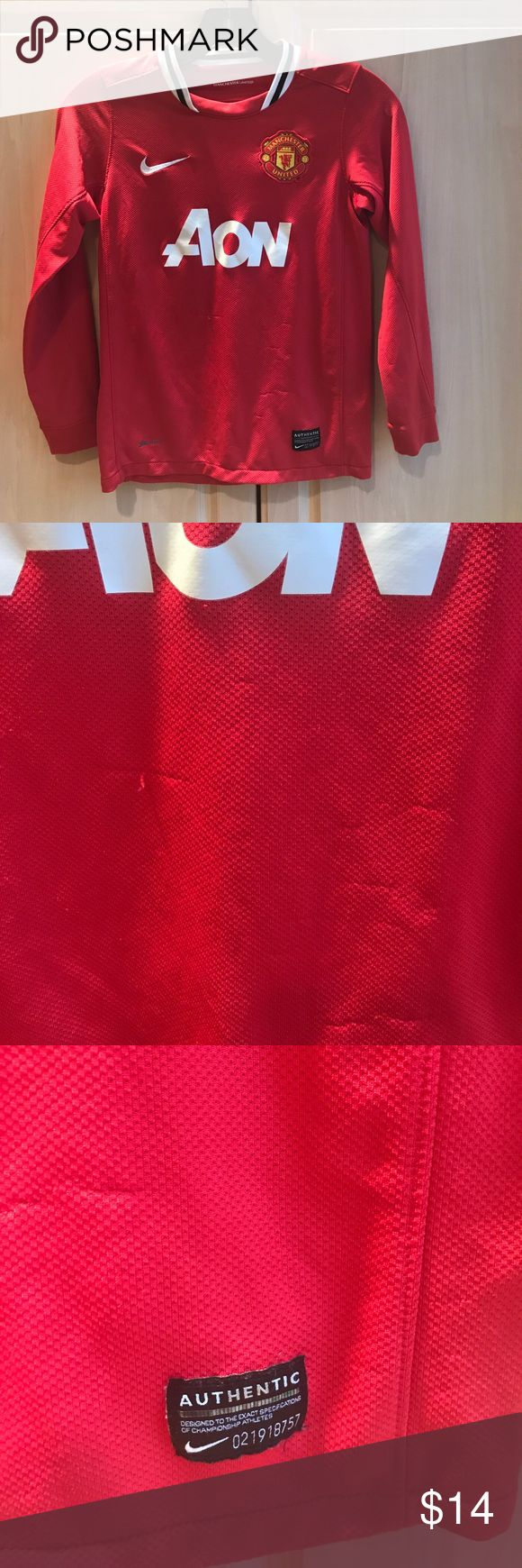 ⚽️⚽️NIKE MANCHESTER UNITED ⚽️⚽️CHILDS SHIRT Dri fit child's small would fit approx size 7-8. Pulling in front of shirt. See photo 2. Nike Shirts & Tops Tees - Long Sleeve