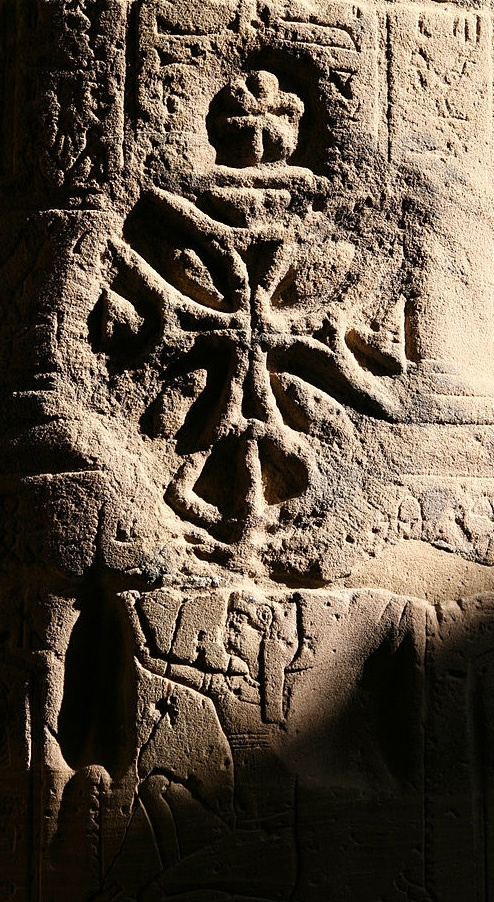 The Coptic Cross. Look closely and you will see An Ancient Egyptian carrying it. Was this Cross censoring the pagan carving? Or was the Christian carver making a subtle statement regarding the important role Egypt played in upholding the faith?