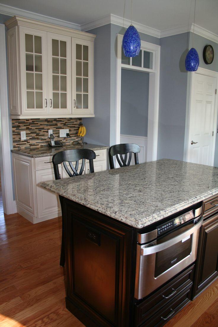 Kitchen island featuring waypoint cabinetry in maple espresso rhode