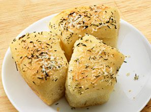 A pinch of salt, sprinkle of thyme and grated Parmesan cheese make everyone's favorite, Sister Schubert's Parker House Style Rolls, even tastier.