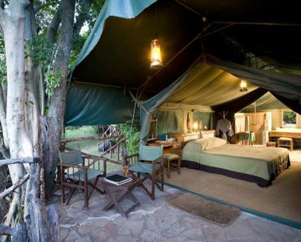 KICHWA TEMBO TENTED SAFARI CAMP- nestles below the Oloololo Escarpment of the Great Rift Valley, affording spectacular views of the Masai Mara's game-filled plains. Kichwa Tembo's spacious canvas safari tents offer magical views over the Masai Mara grasslands or the Sabaringo River. The main thatched guest areas include a welcoming bar/sitting area, indoor and outdoor dining areas and a well-stocked gift shop featuring African art, artifacts and safari-wear.