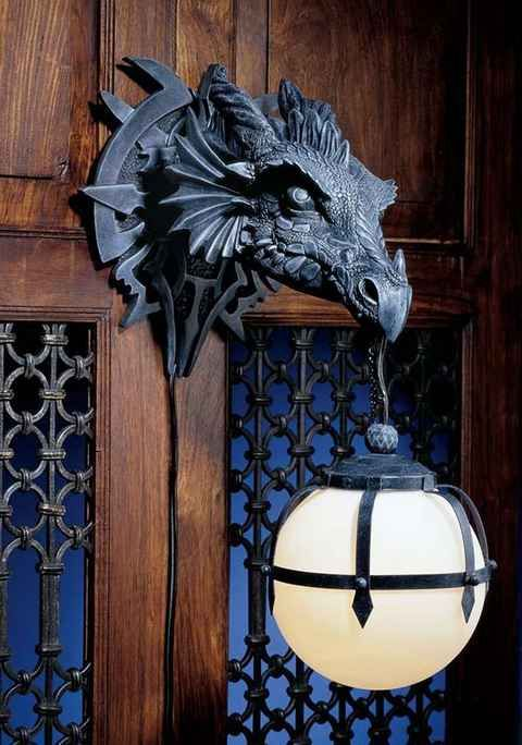 Dragon sconce to light your way, because the night is dark and full of terrors.