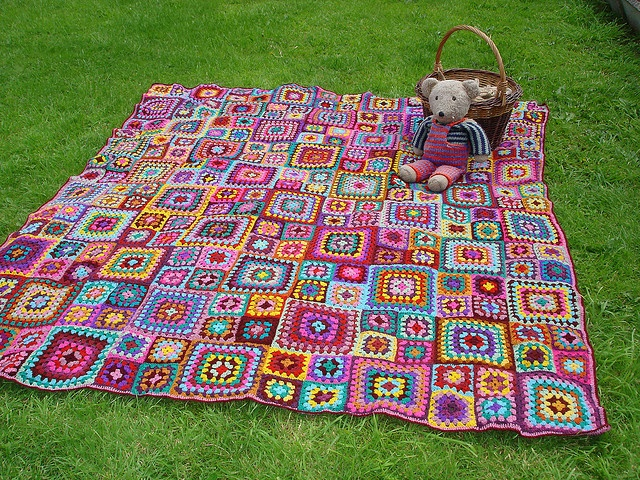 Crochet Granny Square Blanket - I love the bright colors and the look and feel of a patchwork quilt in this blanket