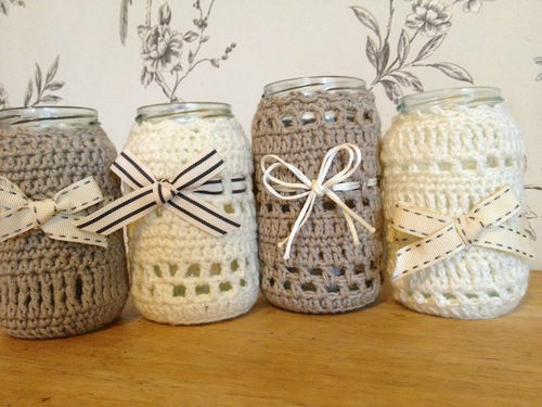 Handmade crocheted Wedding Vases. Get a bunch of jars, crochet covers in the wedding theme colours, fill with tea lights for centre pieces?