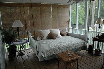 Suspended bed on a summer sleeping porch.
