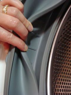 clean Washing machine: 1 c white vinegar & 1 cup baking soda into the drum. 1/2 cup vinegar & 1/2 cup baking soda into dispenser. HOT cycle. High spin.