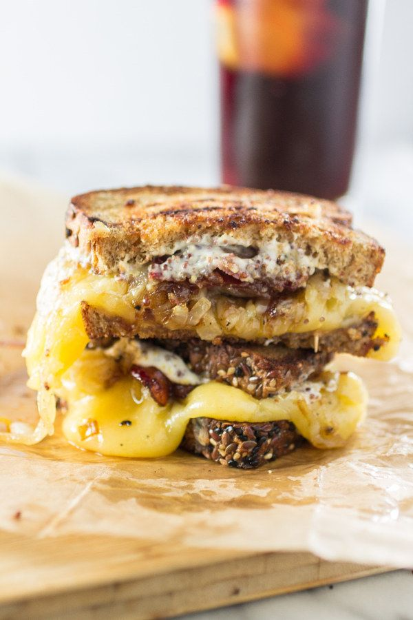 """Turn the worst of days around with this """"train wreck"""" grilled cheese sandwich made with gouda, caramelized onions, and maple bacon."""