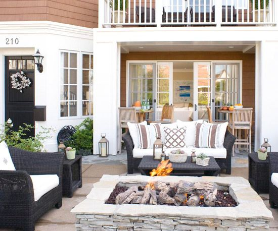 Love this extended outdoor living space with the open fire pit