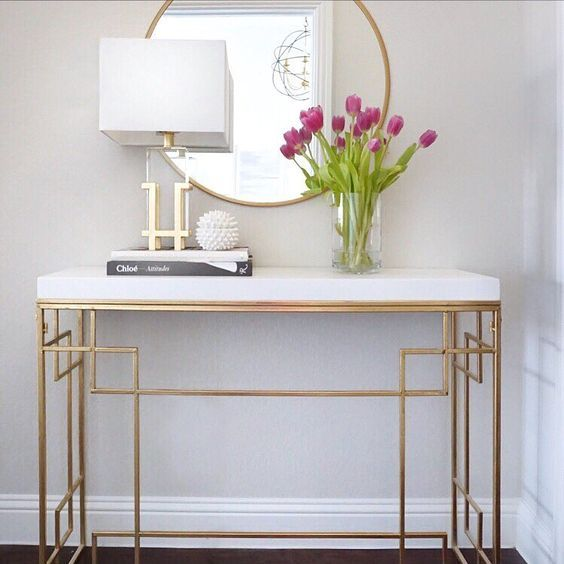 Entryway console table ( round gold target mirror )   See this Instagram photo by @thedecordiet •