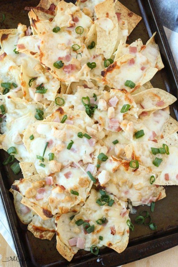 Chicken Cordon Bleu Nachos: chicken, ham, mozzarella and a drizzle of Alfredo sauce! The perfect gooey, cheesy nachos for game day, movie night, or a quick lunch. www.thereciperebel.com