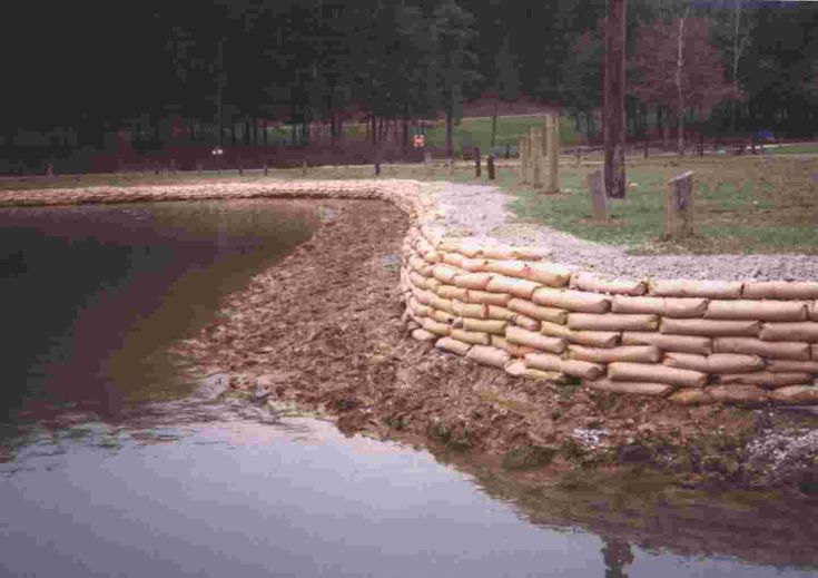 Concrete bag retaining wall- the bags wear away over time and give you this amazing looking wall! Description from pinterest.com. I searched for…
