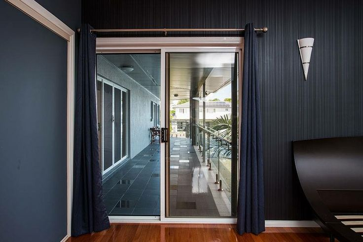 ForceField Stainless Steel Sliding Security Door, on a luxury home in Sunnybank Hills in Queensland.