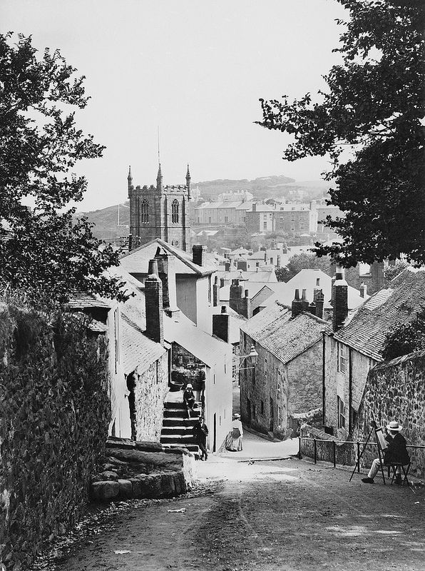 St. Ives, Cornwall - A view looking down Barnoon Hill toward the town. The entrance to Ayr Lane can be seen on the right. Barbara Hepworth's studio former home now occupies the house on the corner. The building behind the steps on the left later became the site of a cinema (Palais de Danse) and then was subsequently used as a studio by Barbara Hepworth in the 1960's.