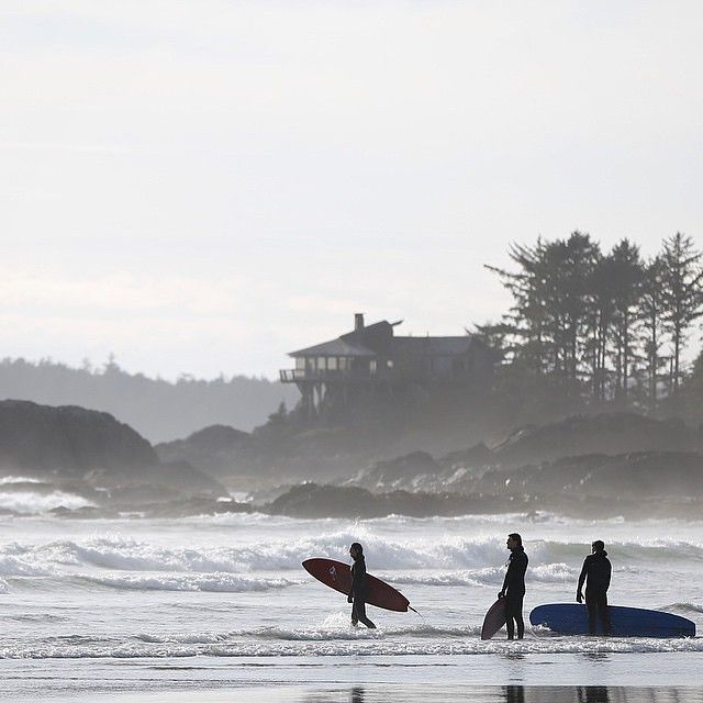 Surfers heading out to catch some waves at Chesterman Beach in Tofino on Vancouver Island's west coast.   (photo: @eivindhauge via Instagram)  #explorebc #explorecanad
