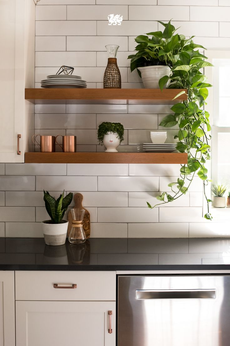 Create A Cozy Kitchen With Open Shelving, Fresh Plants, Rustic Woods, And  Novelty Accents. Natural Light And Clean Countertops Finish Off The Look.