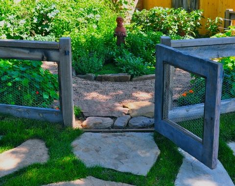 easy-to-build chicken wire fence surrounding vegetable garden; what a pretty way to keep out those pesky deer!