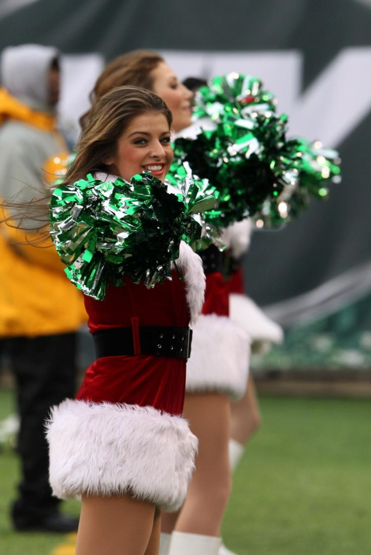 New York Jets' cheerleaders perform during the second half of an NFL football game between the Oakland Raiders and the Jets, Sunday, Dec. 8, 2013, in East Rutherford, N.J.