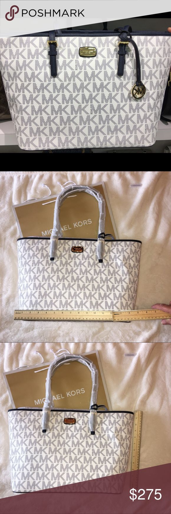 NWT Michael Kors Large Navy and White Tote NWT Michael Kors large tote bag in navy blue and white.  Great colors and style for the summer! Very roomy inside with a large zippered pocket, and four open pockets.  Outside back has an open pocket as well (see photos).  Has a gold clip latch closure and gold MK dangling emblem on front handle.  This is a gorgeous bag!  New in original packaging.  No trades on this item. KORS Michael Kors Bags Totes