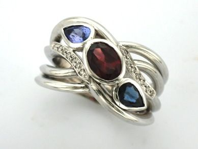 'MARTINA' -- Gorgeous Family Ring designed with Garnet,  Sapphire & Tanzanite with Accent Diamonds.  Celebrating January, September & December Birthdays.  Custom made in 18ct White Gold!
