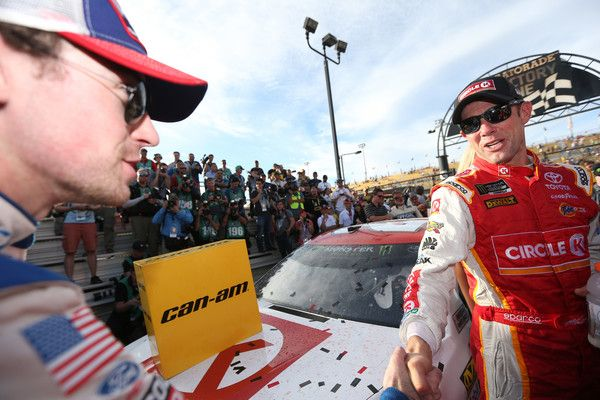 Matt Kenseth, driver of the #20 Circle K Toyota, is conrgratulated after winning by Ryan Blaney, driver of the #21 SKF/Quick Lane Tire & Auto Center Ford, during the Monster Energy NASCAR Cup Series Can-Am 500 at Phoenix International Raceway on November 12, 2017 in Avondale, Arizona.