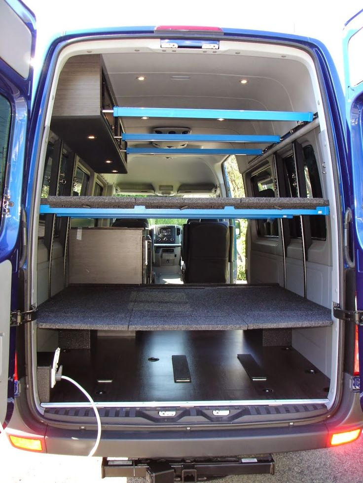 """Sprinter for 'Anything"""" . Surfboard storage at top, sleeping for 4, nice refrigerator, sink ,110v power, The racking and beds remove in seconds.We also…  -  American Van Works - Google+"""
