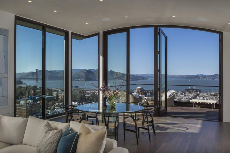 """Listed for $40 million, this newly-constructed mansion occupies an unparalleled plot overlooking the San Francisco Bay. The seven-bedroom, eight-bath home is situated in the exclusive subset of the city's Pacific Heights neighborhood known as """"Billionaires Row."""" Notable neighbors include Apple's Jony Ive, Oracle founder Larry Ellison, and Ann and Gordon Getty. The home is one of only 17 houses on the view side of the street, meaning each of the five stories takes in rare sweeping views of…"""