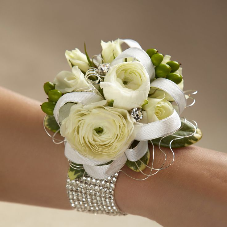 Stunning ranunculus corsage, diamond wristlet and silver accessories