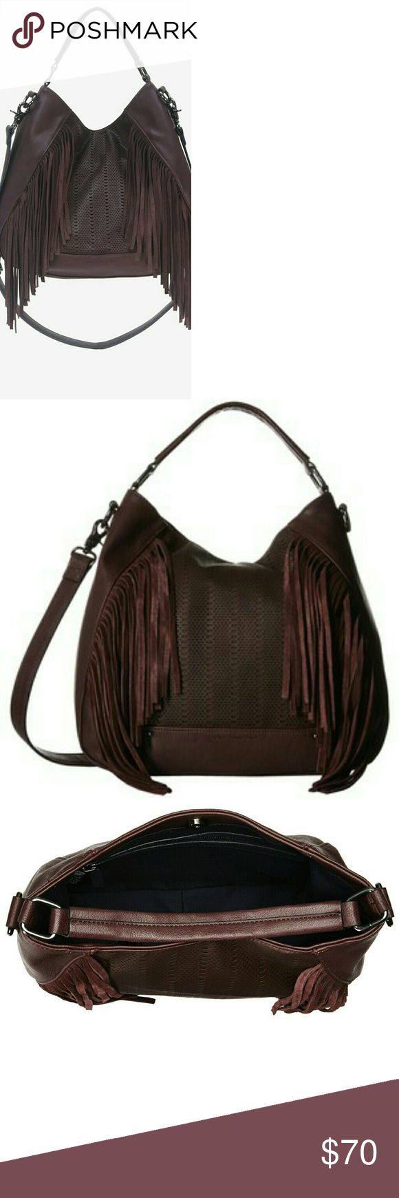French Connection Rose Hobo French Connection Rose Hobo in 'Biker Berry'. Vegan leather with edgy laser cut design and fringe details. Modern and sleek. Elegant leather look. Detachable crossbody strap included. French Connection Bags Hobos