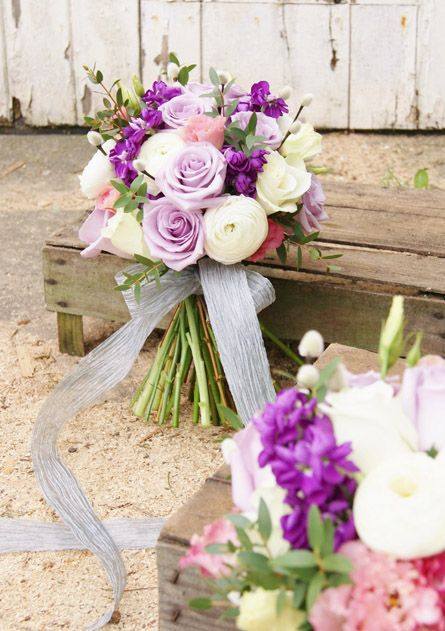 Florissimo, Shropshire | For wedding flowers consultations get in touch at http://flowersbyflorissimo.co.uk/contact | Spring vintage-chic hand-tied bridal and bridesmaids' bouquet of lavender ocean song roses, pussy willow, purple stock, white ranunculus and frilly pink lisianthus.