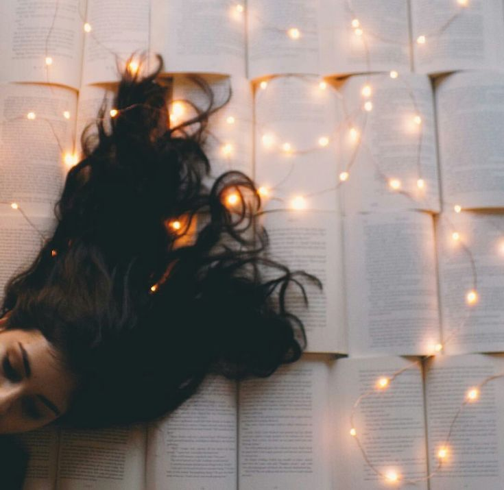 dark brunette | fairy lights | string lights | books | read | pages | sleep