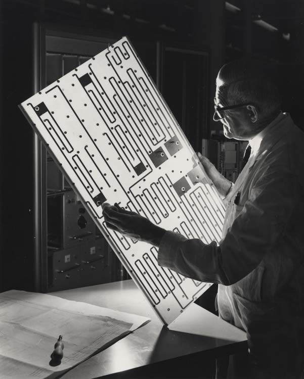 Man examining printed circuit board, part of STAN.37 instrument landing system, 1966. IET Archives NAEST 211/02/22/01 T.4210
