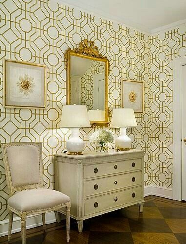 A classic console and chairs with classic gold mirror and to add neo factor white and gold wallpaper on the wall