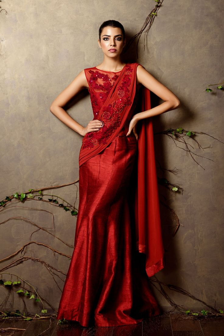 A pompeien red constructed saree with a tulle bodice. The bodice and the front drape are embellished with tone on tone thread embroidery and watery shimmer sequins. Sales@shyamalbhumika.com www.shyamalbhumika.com