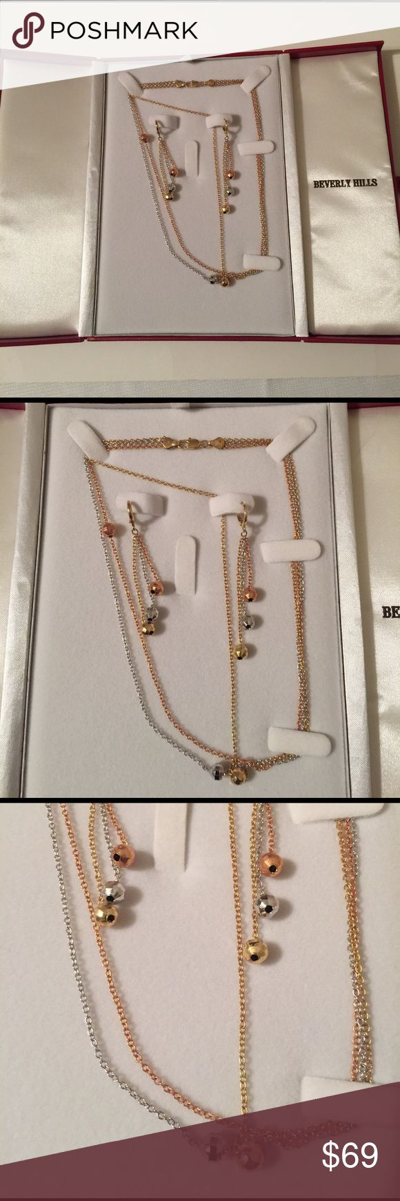 Brand-new Beverly hills necklace set earrings Brand-new Beverly heels necklace set in silver and rose gold tone chain. Necklace and long earrings. Comes in a beautiful red box. Check out my closet, we have a variety of Victoria Secret, Bath and Body Works, handbags 👜 purse 👛 Aerosoles, shoes 👠fashion jewelry, women's clothing, Beauty products, home 🏡 decors & more...  Ships via USPS. Don't forget to bundle, you save big! Always a FREE GIFT 🎁 with every purchase!!! Thank you & Happy…