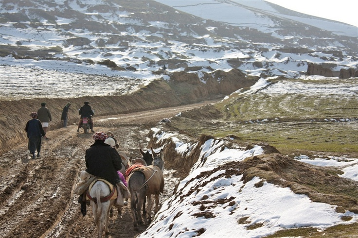 A new road in Pashtun Kot District in Afghanistan's northern Faryab Province. Local villagers, who depend on rain for agriculture, welcome the snow after years of dry weather