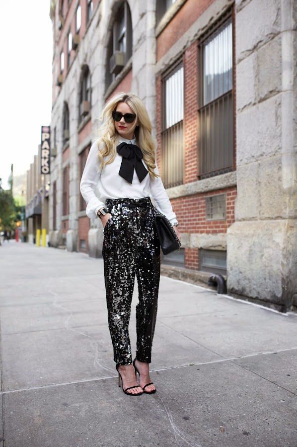 11 cool girl new year's eve outfit ideas - white blouse with black bow, gold sequin trousers + heels