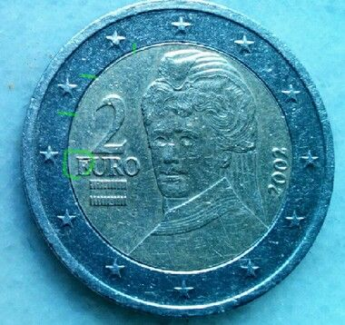 2€ 2002 AU