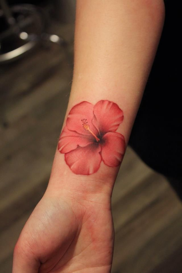I just love the airy, feminine look of watercolor tattoos. This one particularly speaks to me because it is a Hawaiian flower.