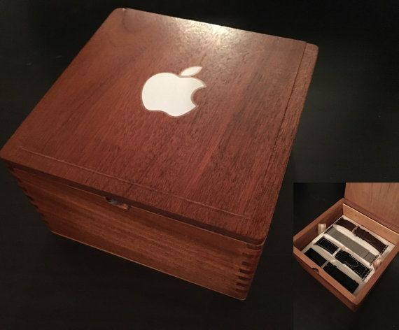 Description: This is not an Apple product. This auction is for a Apple Watch box with a cherry wood finish. This is a great place to store your extra Apple Watch bands. ~ This is a deep wooden box with a false bottom. Safely store up to 8 bands and accessories. ~ Padded lining