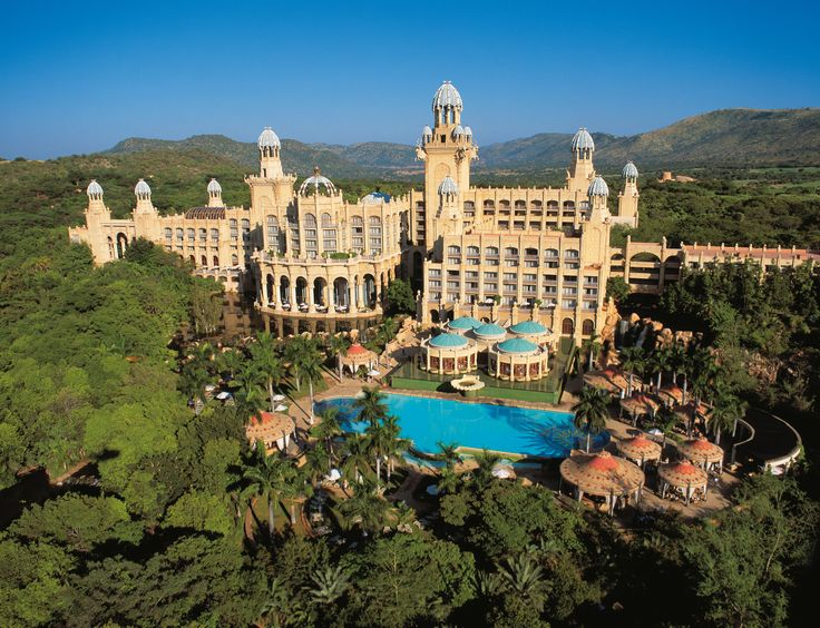 Sun City Resort is set in the stark ruggedness of the North West Region of South Africa, and is surrounded by mountains and the untamed majesty of the African bushveld. Description from perrygolf.com. I searched for this on bing.com/images