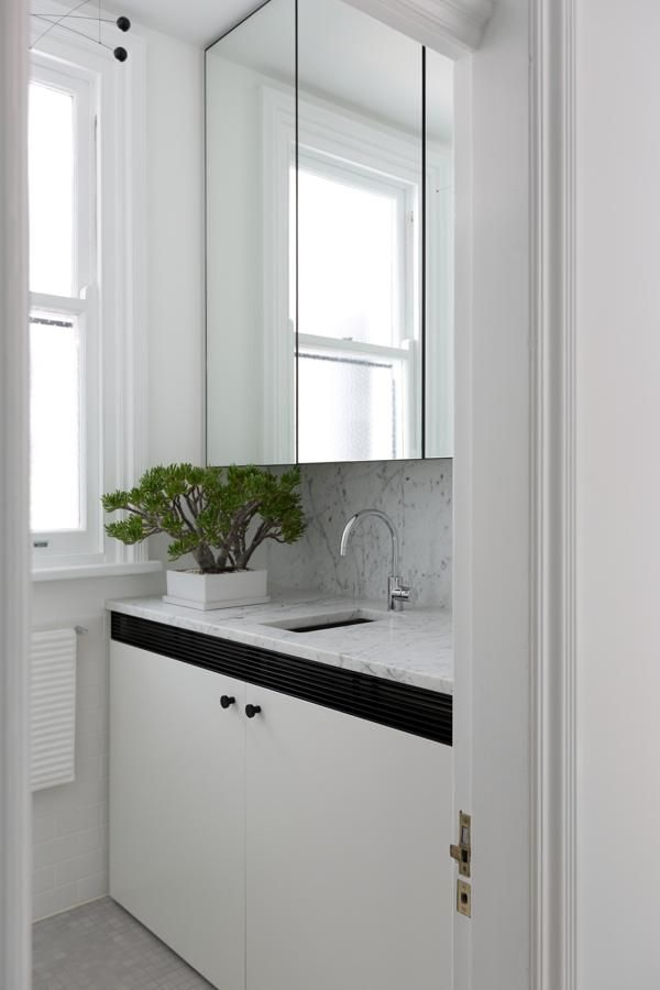 And where color just wasn't enough, other tricks were used. The tiny bathroom has large mirrored cabinet doors which add depth to the space and the green touch is fabulous.