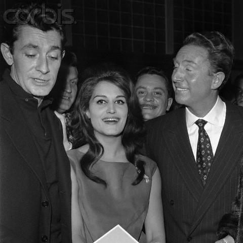 Dalida and songwriter Charles Trenet (R) and singer and actor Jean-Claude Pascal (L) during his premiere at Bobino.