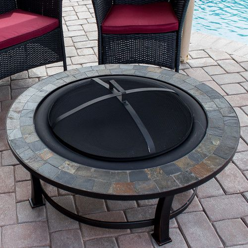"""Features:  -Mesh screen.  -Wood grate.  -Includes 18"""" fire poker.  Product Type: -Fire pit.  Finish: -Black.  Base Material: -Steel.  Pit Material: -Steel.  Hardware Material: -Steel.  Fuel Type: -Woo"""