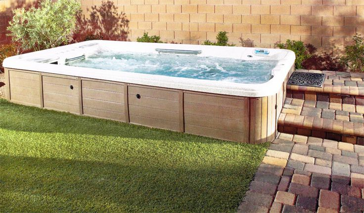 Semi inground tidalfit exercise pool installed photos for Pool spa show vegas