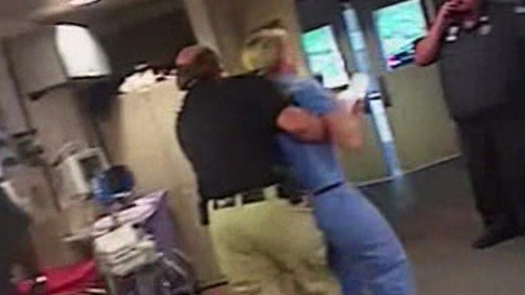 The policeman was filmed unlawfully arresting a nurse who refused to draw blood from a patient.