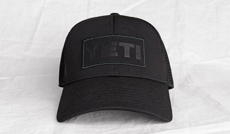 YETI Black on Black Patch Trucker Cap Keep it classic with the Black on Black Patch Trucker. Its all black exterior is made of an Ottoman weave fabric and premium mesh, combining a soft feel with a co