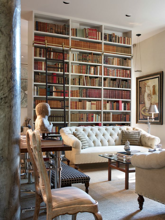 Sleek, Timeless & Totally Contemporary... this is Luis Bustamante's approach to designing a superb library... timeless columns that gives respect to any place and comfortble seating spaces, a library with ladders...