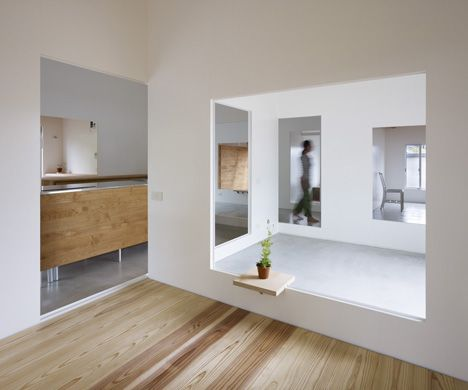 Residents of this Japanese house by Atelier Cube can move from room to room through large holes in the walls.  House in Amagi by Atelier Cube