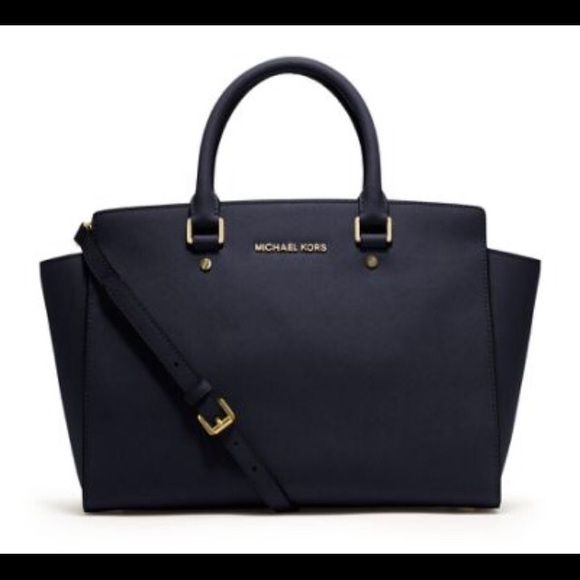 """Michael Kors Selma Satchel MK Large Black Selma. Comes with adjustable strap.  Measurements: 13"""" L, 10"""" H, 5"""" W.  Few scuffs on the feet.   Bought from another seller online, I've decided to buy a different purse since and never used it.   Purse has been used by prior owner but after I've taken care of it, still has a lot of life left.  Seller didn't mention light cigarette smell. I can put some febreeze or a dryer sheet whatever new buyer wants. Has 1 pink stain inside (like nail polish…"""