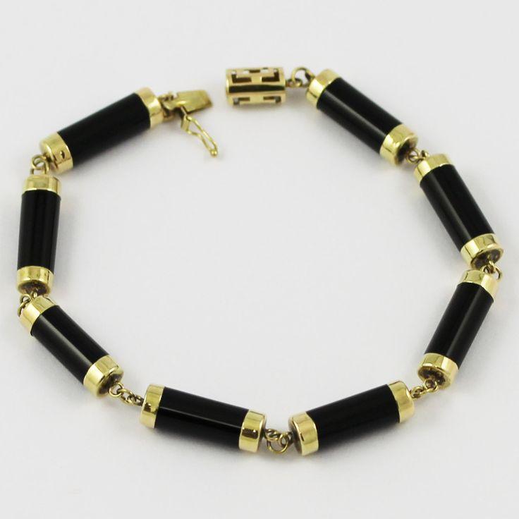 One elegant 14k yellow gold onyx bracelet.